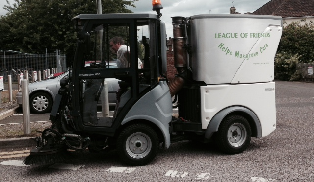 New mini dustcart cleaning up Musgrove, bought with donations from the League of Friends